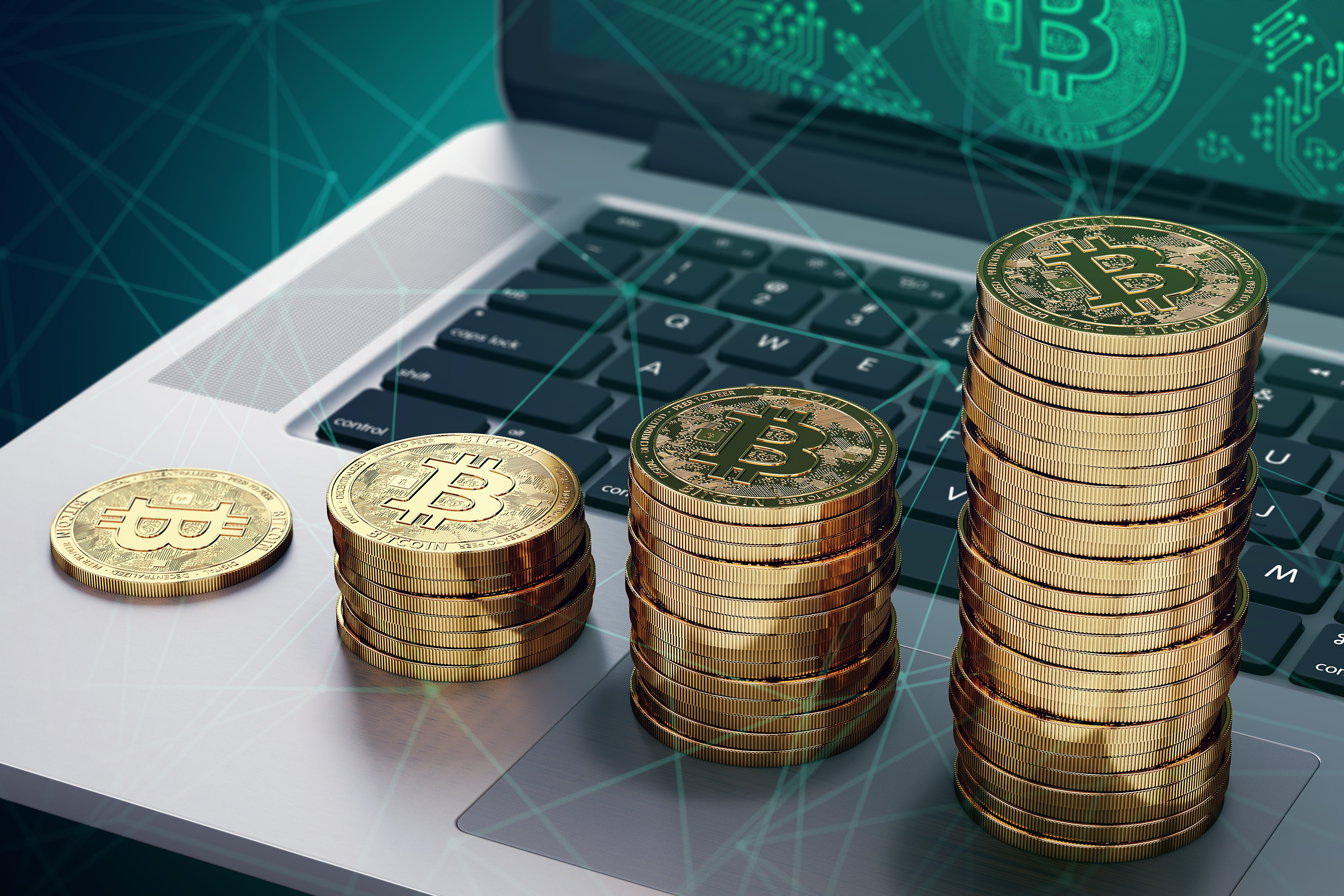 bitcoin stacking up on a laptop