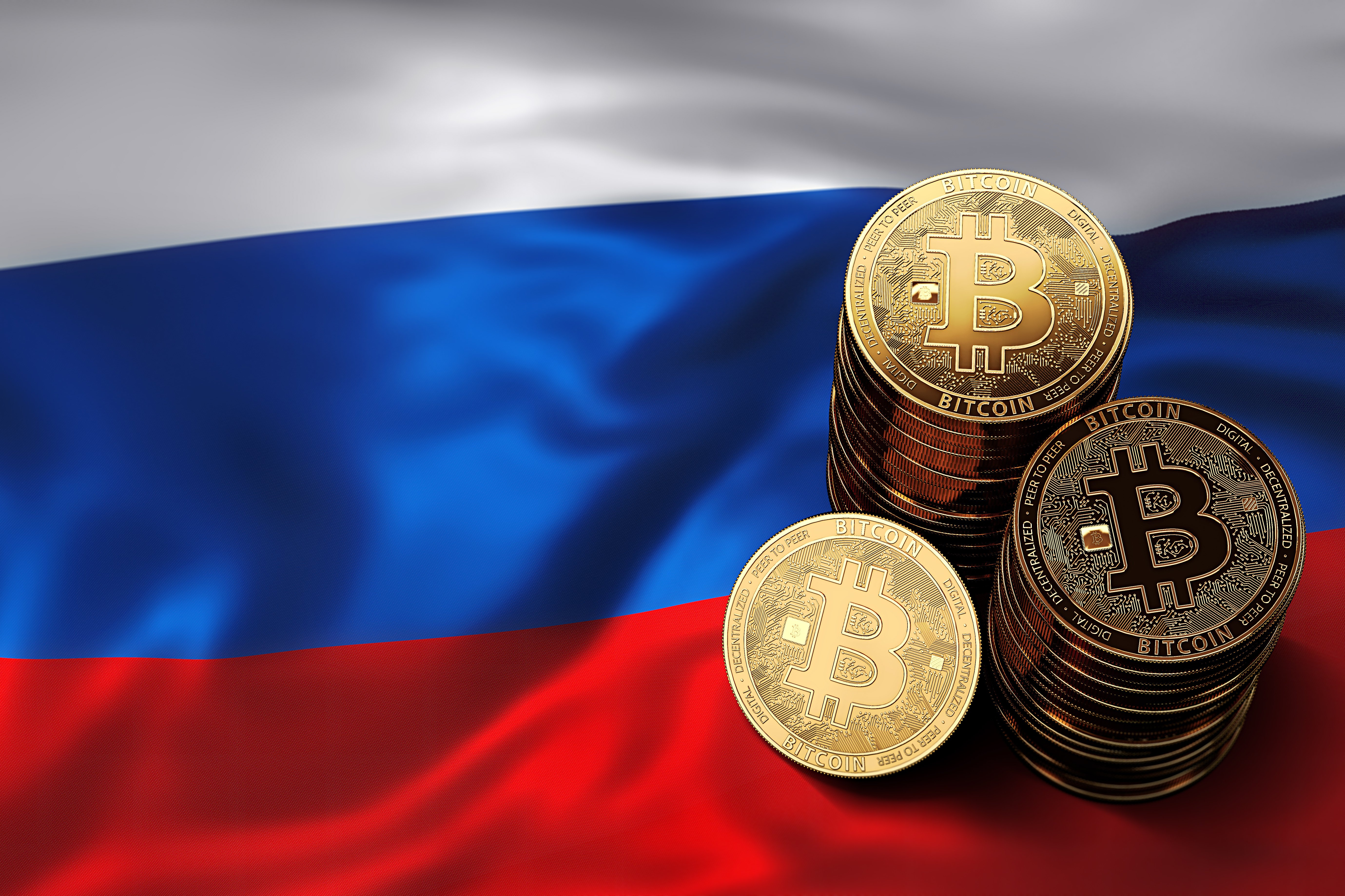 bitcoins stacked on russian flag