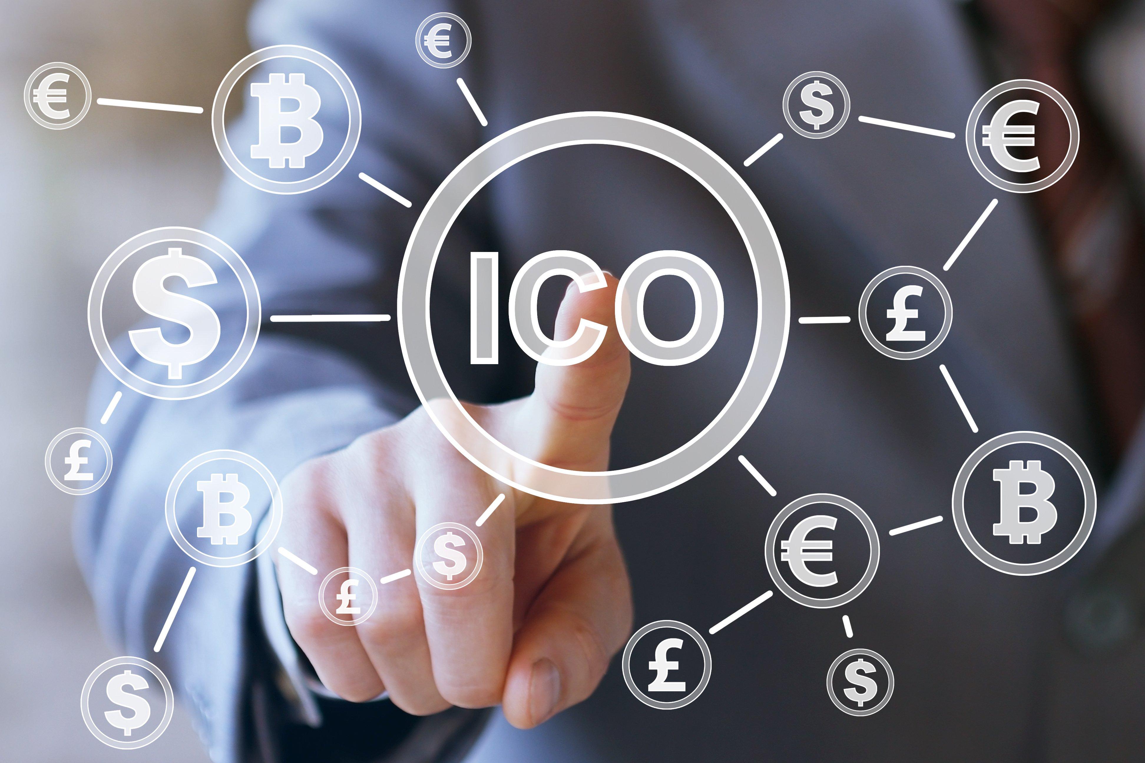 businessman touching ico icon on screen