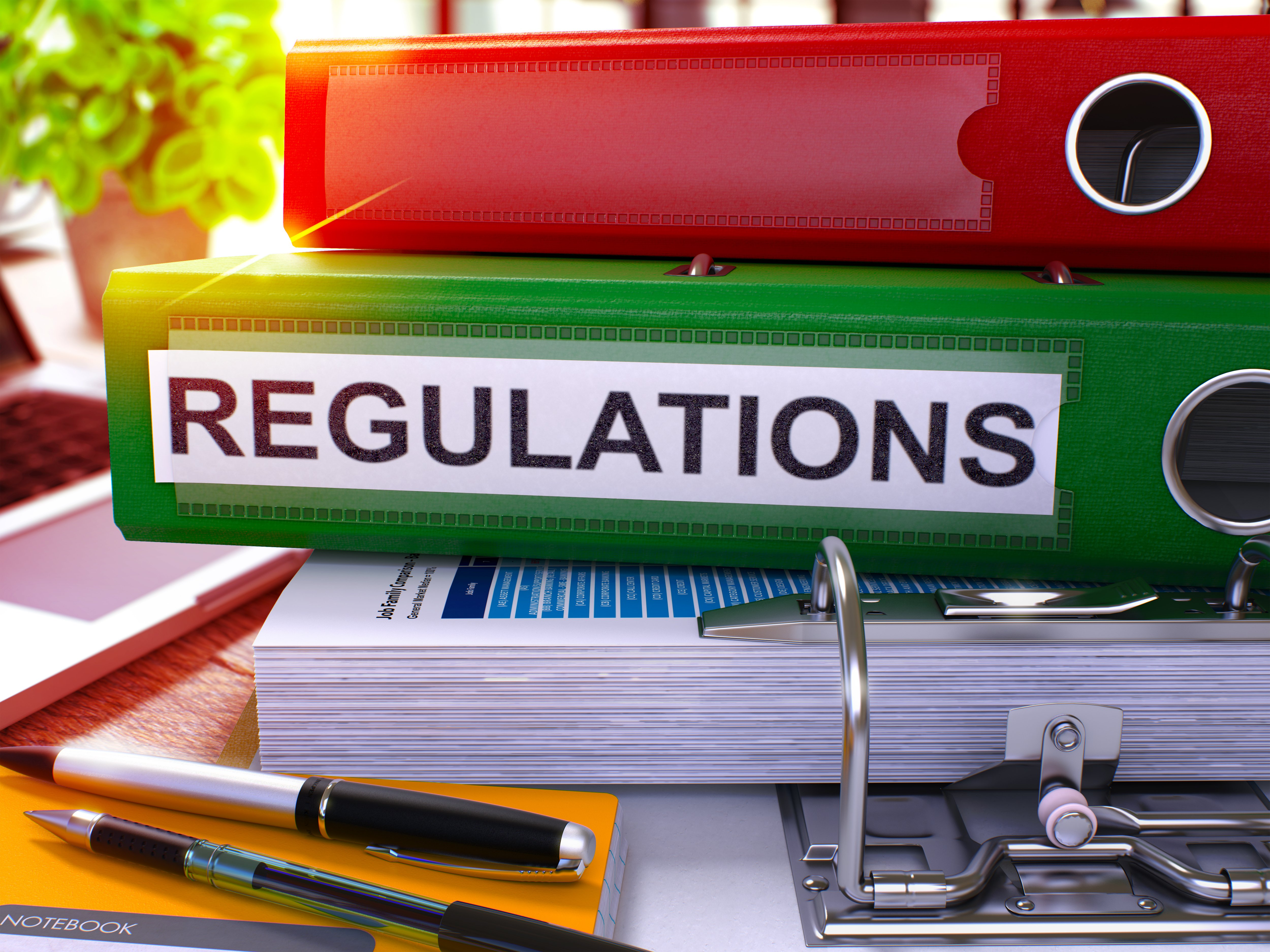 green regulations folder on desk