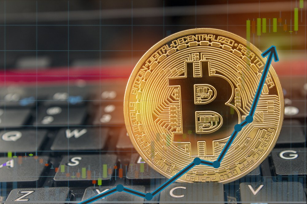 bitcoin with blue upwards arrow on keyboard