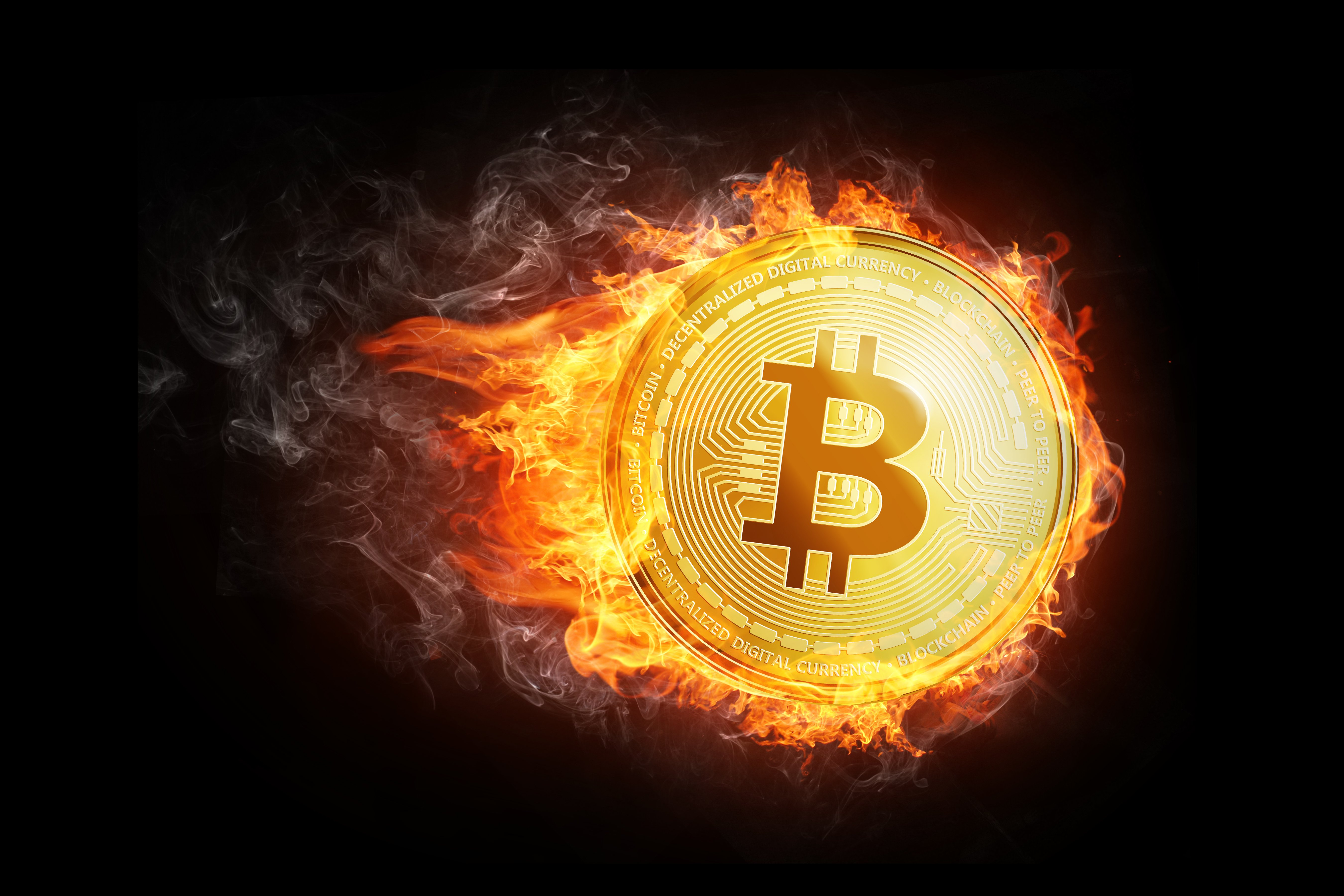 Golden bitcoin coin flying in fire flame