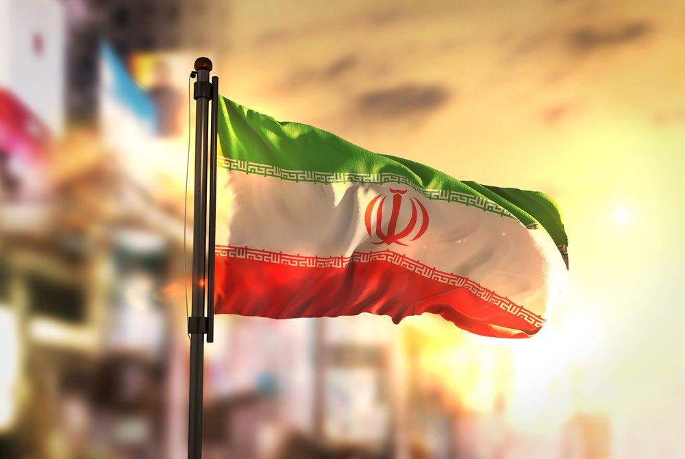 iran flag against sunset background