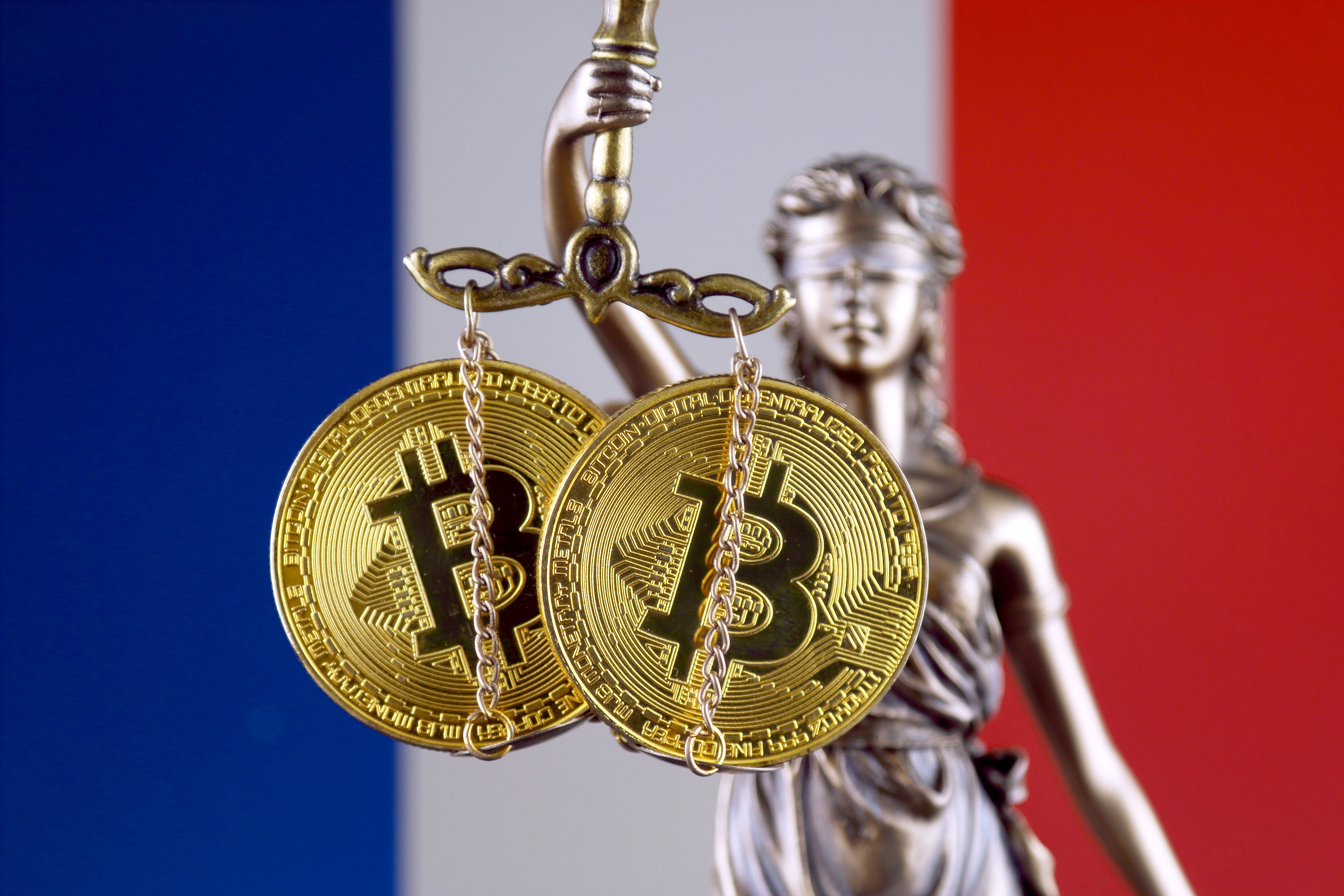 law and justice symbol holding bitcoin in front of french flag