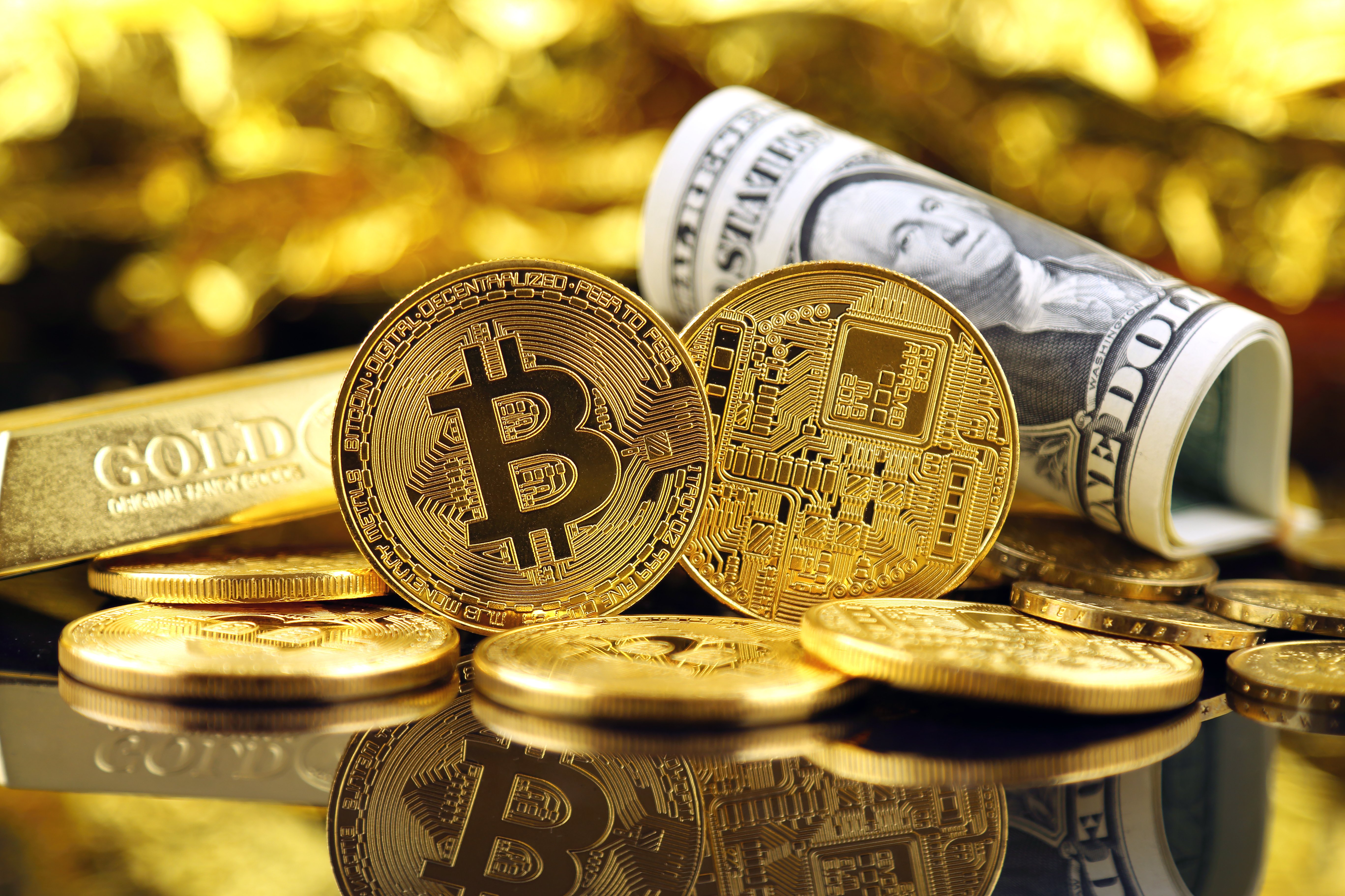 physical bitcoins and dollar notes