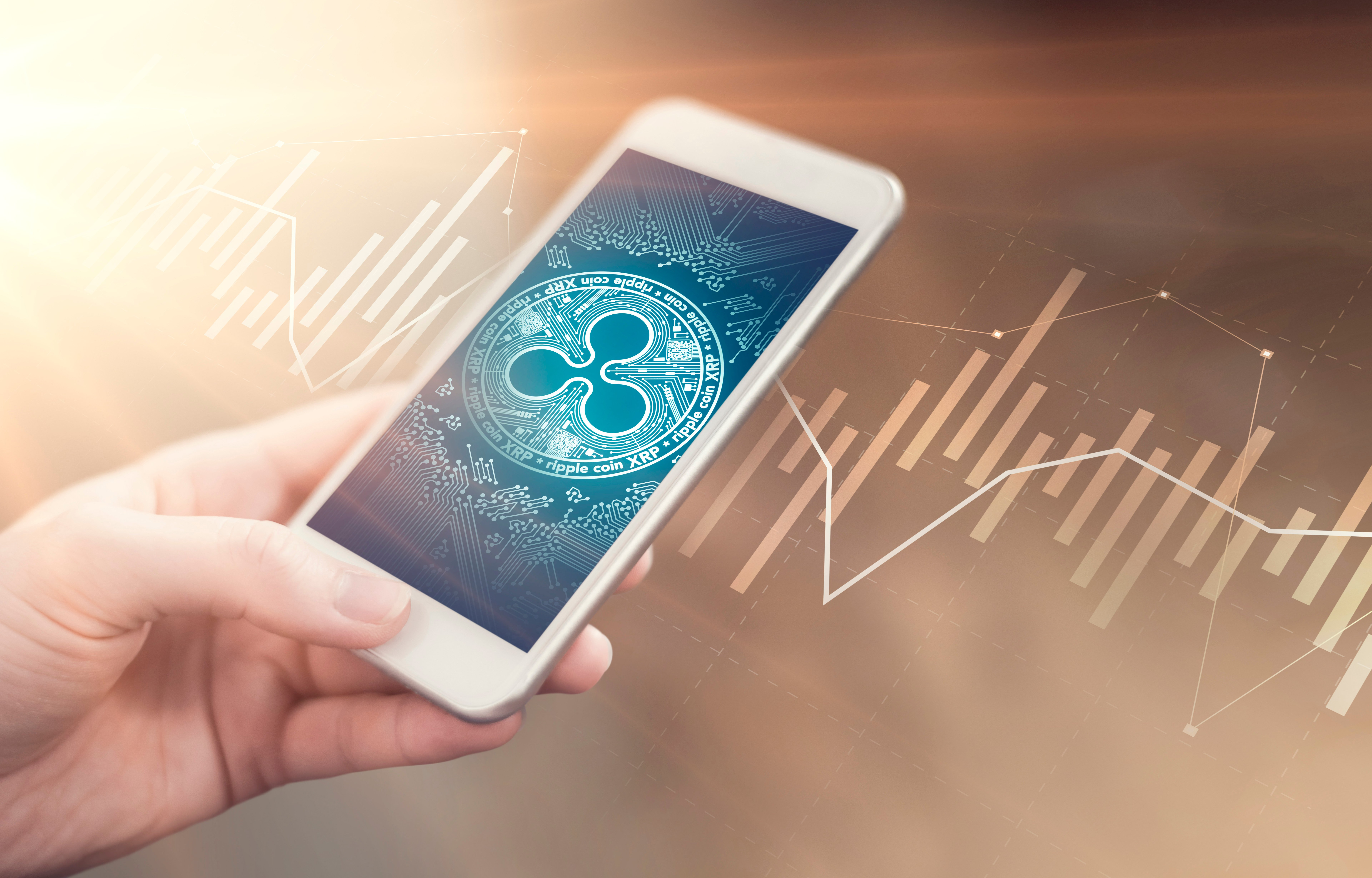 ripple logo on smartphone