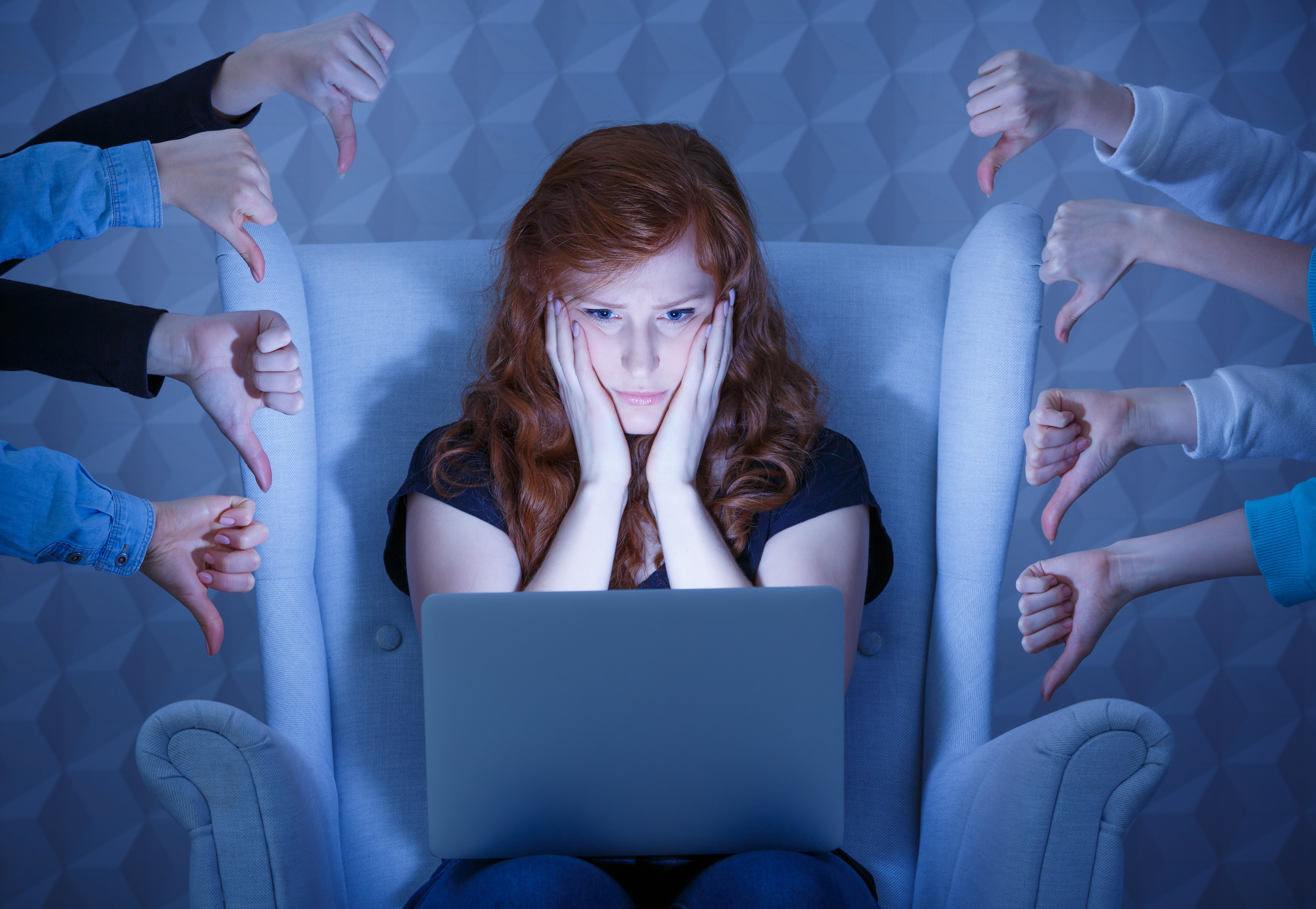 Worried young woman having negative comments on her website