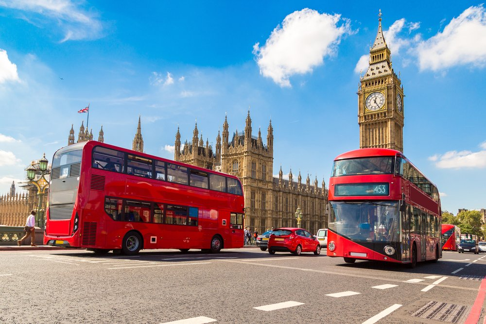 Westminster Bridge and red double decker bus in London