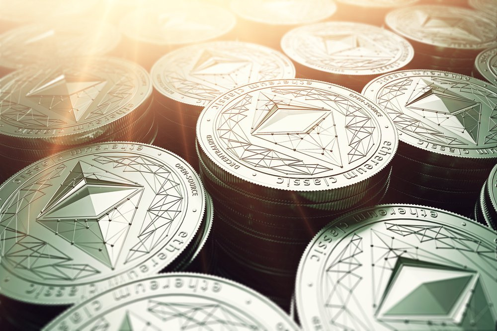 Ethereum classic coins in blurry closeup with sunburst from above