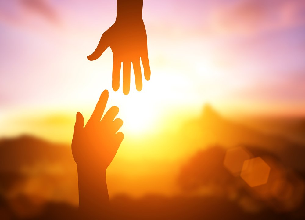 silhouette of helping hand concept