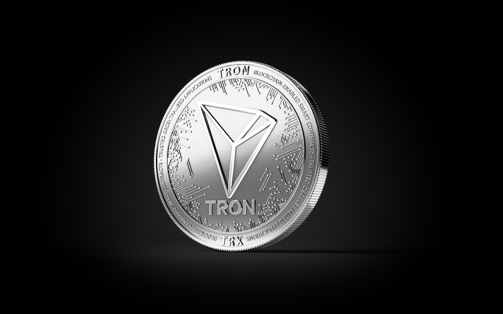 tron coin on black background