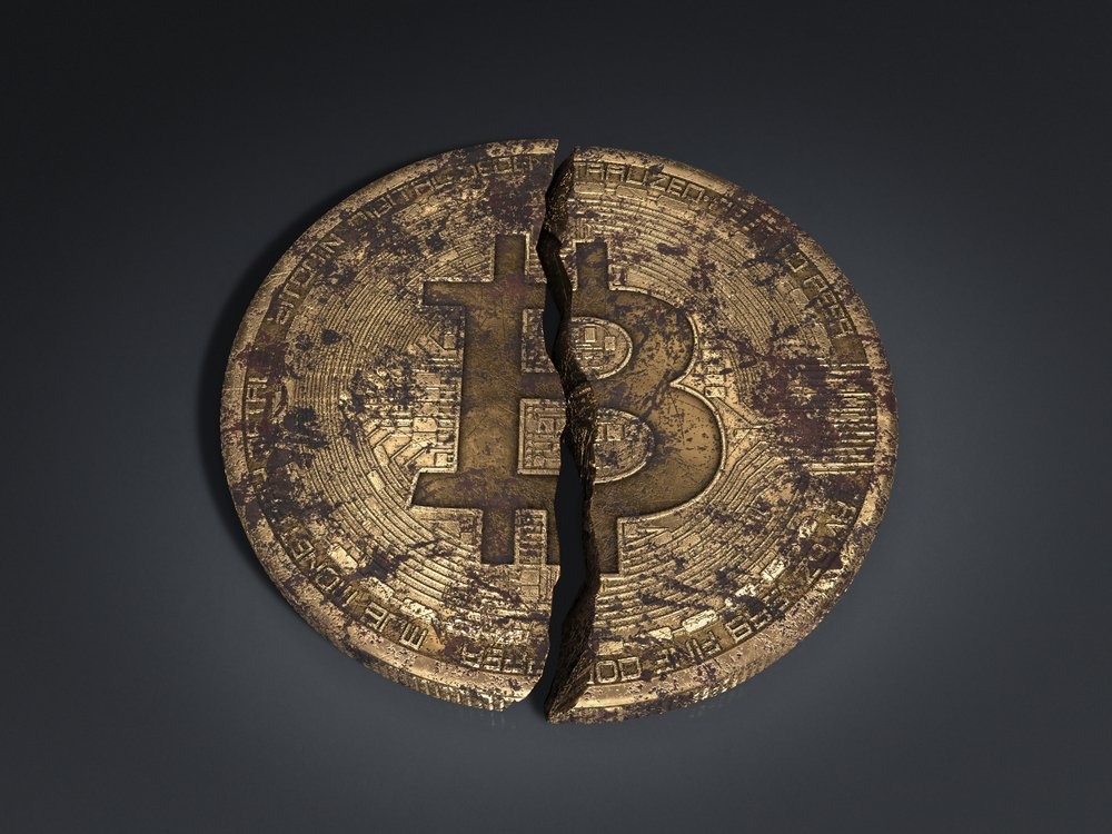 battered old bitcoin broken in half