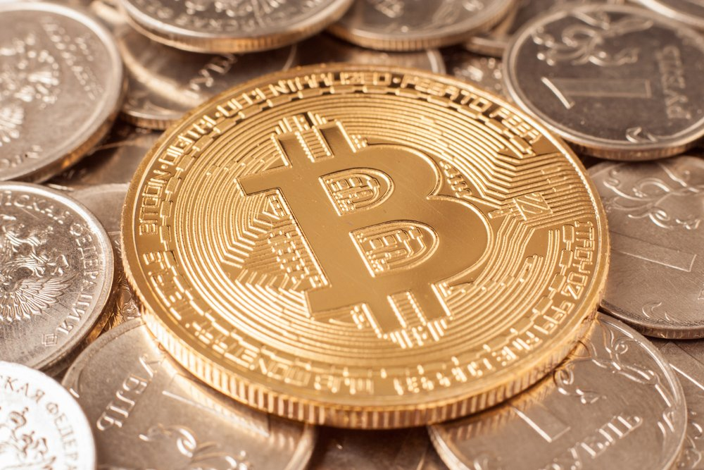 golden bitcoin on dollar coins