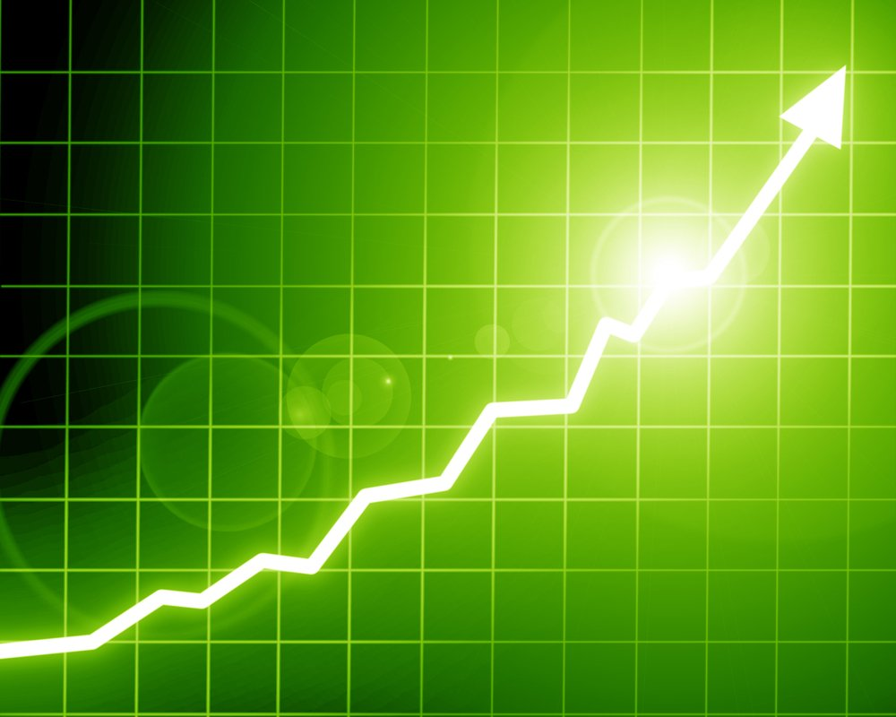 Arrow graph going up on a soft green background