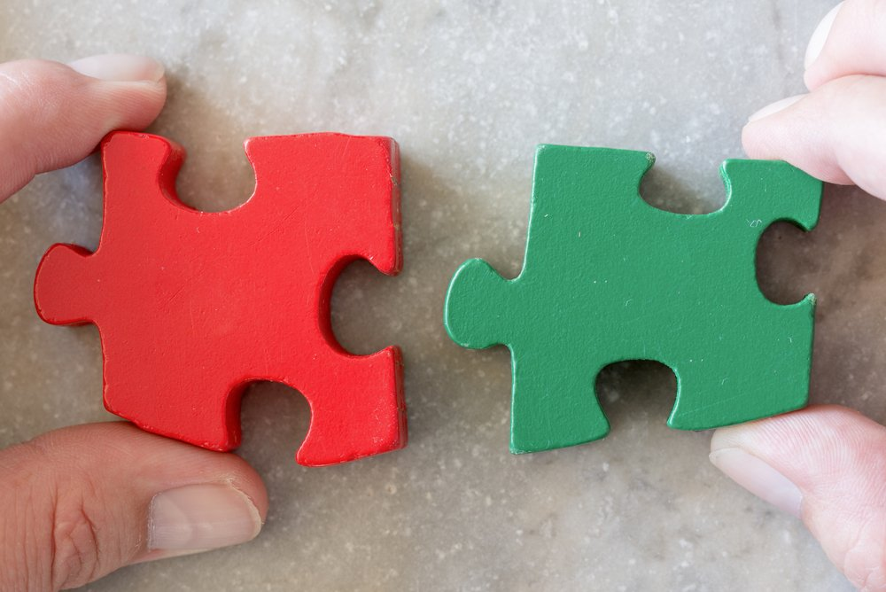 red and green jigsaw pieces