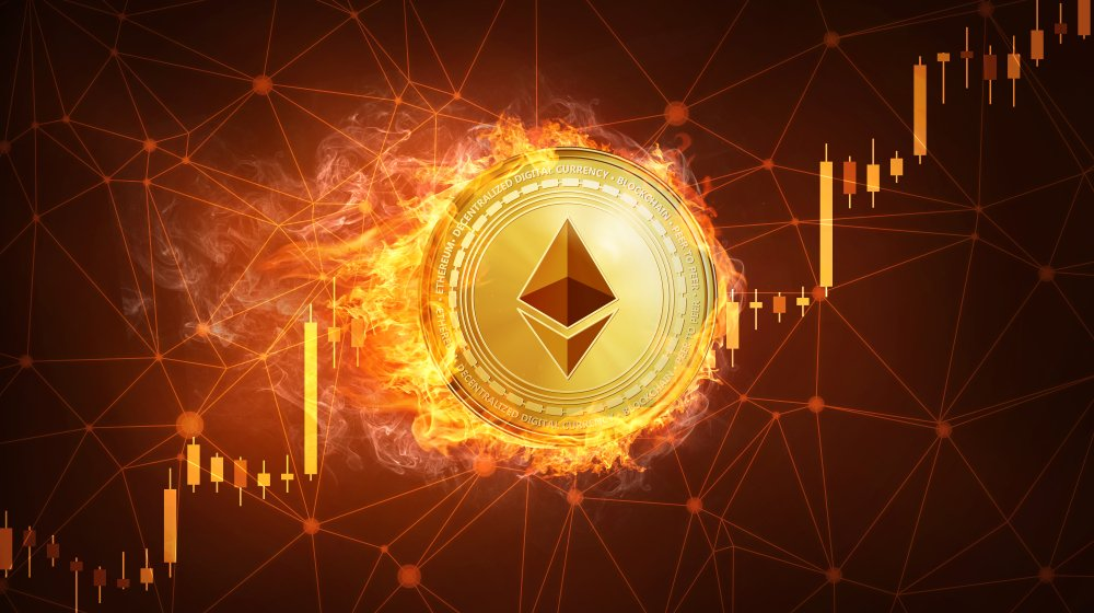 Golden ethereum coin in fire with bull trading stock chart