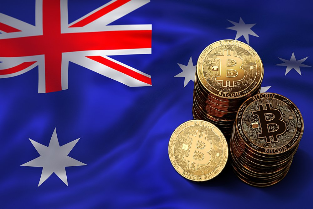 Stack of Bitcoin coins on Australian flag.