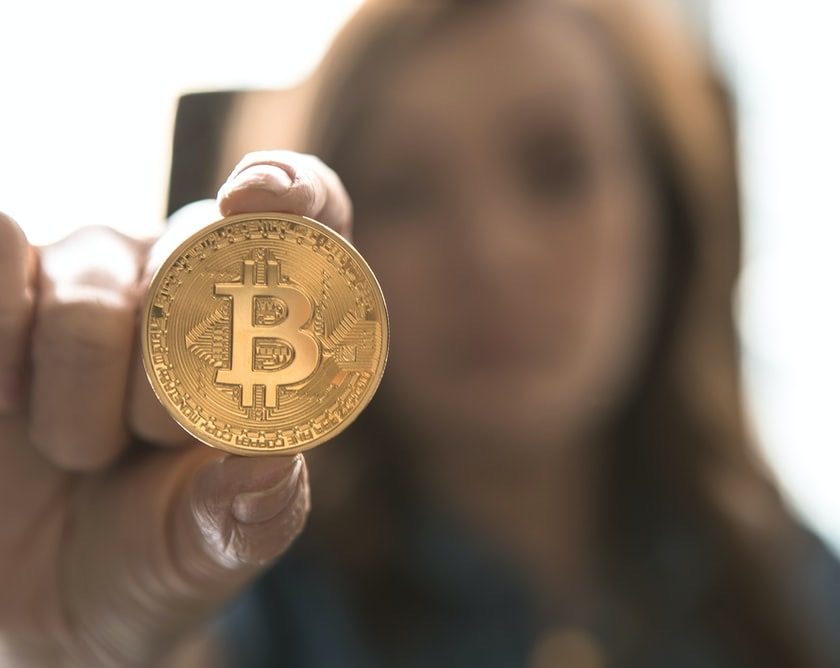 woman holding bitcoin